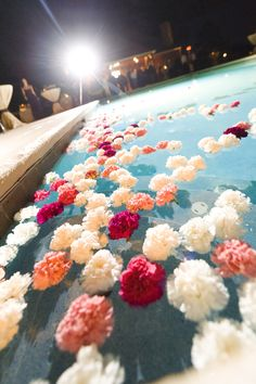 Pool Wedding Ideas pool backyard wedding decorations with large round tables and small upholstery chairs also large tent Hailey Hollander Only Peachy And White Flowers Floating In The Pool Dahlias And Roses