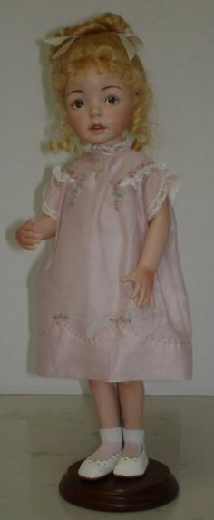 """This is a 12"""" doll, all porcelain with painted eyes and a mohair wig. Her costume is made of the finest swiss batiste and cotton laces. It is finished off with hand embroidery. The mold company is Expressions, she is sculpted by Diana Effner."""