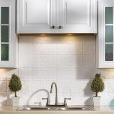This Backsplash Kit includes six 18 in. x 24 in. backsplash panels, four 4 ft. J-Trim pieces, two 18 in. Inside Corner pieces, one package of matching Outlet Covers and four rolls of Double Sided Tile Decorative Wall Tile Adhesive Tape.