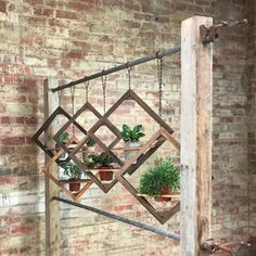 43 Charming Outdoor Hanging Planters Ideas to Brighten Your Yard The back porch is a superb place to Succulent Wall Art, Timber Walls, Decoration Plante, Garden Planters, Hanging Planters Outdoor, Balcony Planters, Planter Pots, Hanging Plant Wall, Outdoor Wall Art