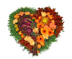 Sorgdekoration i hjärtform, höstfärger http://holmsundsblommor.blogspot.se/2014/11/blomsterhjarta.html
