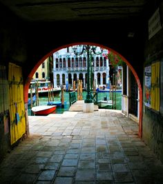 VENICE, ITALY- Tunnel looking out towards the canal next to Rialto Bridge