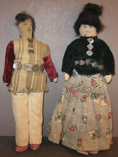 Pair of Old Handmade Navajo Tourist Dolls with tin adornments