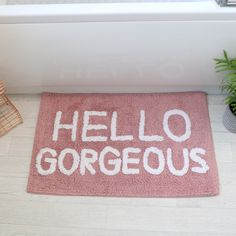 This Pink Bath Mat - Hello Gorgeous is a pretty home accessory for lovers of pink home decor or quirky home accessories. This Mat is made from polyester with a pink rectangle design. White writing on the front of the Mat spells out Hello Gorgeous. Gorgeous Bathroom, Pink Home Decor, Dorm Bathroom, Pink Bathroom Rugs, Girls Bathroom, Pink Bath Mat, Pink Bathroom, Pink Bathroom Decor, Hello Gorgeous