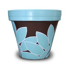 This 8-inch hand painted flower pot has a large graphic robins egg blue flower on a chocolate brown background. I outlined the flowers with white ink to give it a bold graphic look. It can be used as a centerpiece, silverware caddy or mantel decor. Or, if you're not quite the entertainer, just stick a fern in it and sit back for all to admire! $22.00