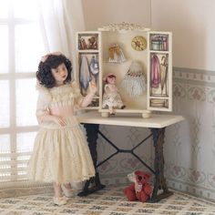 Doll House doll showing off her doll. Miniatures.