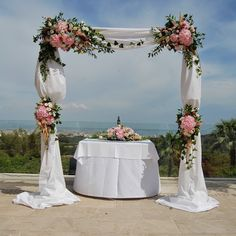 Our wedding arch with gorgeous rose, hydrangea and lisianthus blooms, overlooking the bay of Palma