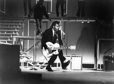 "Aside from his musical genius, he was a remarkable performer and is well known for his ""duck walk"" as he played the guitar. Above, Mr. Berry at the TAMI Show on December 29, 1964 at the Santa Monica Civic Auditorium in Santa Monica, California."