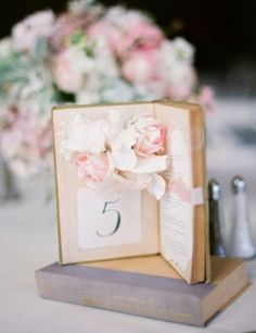 How about book table centerpieces and table numbers for your wedding? Wedding Table Themes, Wedding Table Numbers, Wedding Menu, Wedding Centerpieces, Diy Wedding, Wedding Planner, Dream Wedding, Wedding Decorations, Wedding Cake