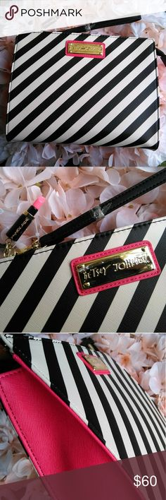 """Betsey Johnson NEW wristlet clutch NWOT  black and white stripes, hot pink on sides Floral fabric inside Cute 💄 keychain  Length: 10"""" Width: 3"""" Depth: 8"""" Betsey Johnson Bags Clutches & Wristlets"""