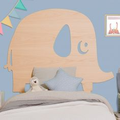 A sweet baby elephant headboard for a child's bedroom