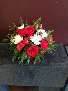Fantastic Merry Christmas Arrangement. It will really bring the holiday cheer to any table setting.