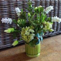 Custom permanent botanical spring floral arrangement featuring hydrangea, tulips, verbena, and grape hyacinth. Designed by myself at buds 'n bloom. $60.00