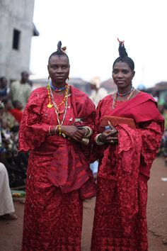 Pictured is Doyin Olosu, the Chief Priestess of the Osun (Oshun) shrine in Oshun State. These photos were taken at the Shango Festival on August 27, 2011. Their beautiful, red embroidered lace clothing is in honor of Shango.