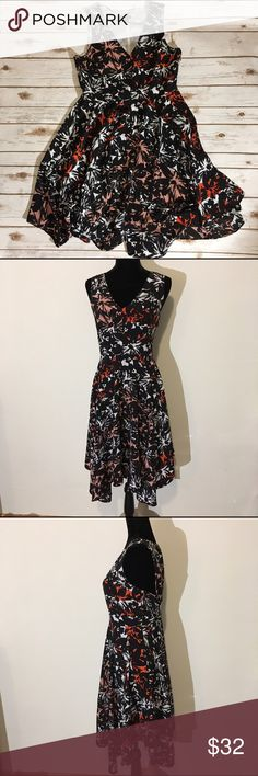 """Metaphor floral dress with symmetrical hemline Metaphor floral dress featuring hidden side zipper and asymmetrical hemline 🌟Size- Women's 12 🌟Flat Measurements- 19"""" bust 15.5"""" waist 39"""" from top of shoulder to hem 🌟Material- 100% polyester  🌟Condition- Excellent! No signs of wear and no flaws noted Metaphor Dresses"""