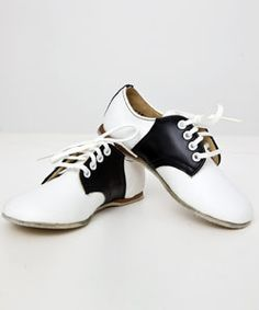 saddle shoes...I hated these things and remember getting rid of them when they got to tight for my feet and getting my first pair of squash heels...oooooo, loved the cracking sound they made on the halls at school...too cool man!