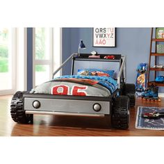 Stunning Boys Bedroom Idea for Kids with Offroad Car Shaped Bed Frame and Cars Cartoon Bedding Set and Shelf also Wooden Ladder Shelving Unit and Blue Wall Paint Color and Laminate Wood Flooring