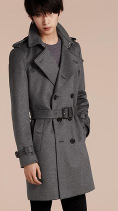 A Burberry trench coat introduced in pure cashmere with smart leather trims to the belted waist and cuffs. Turn back to the collar to display the tonal check accent.