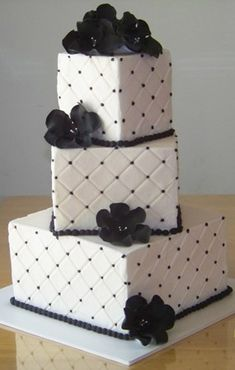 3 tier sq black and white wedding cake.