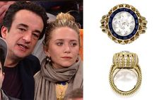"Mary-Kate Olsen's 1950's Cartier antique engagement ring, featuring four carat European cut diamond surrounded by a halo of sapphires.  The gallery has a floral effect of yellow gold ""petals"" containing single cut diamonds"
