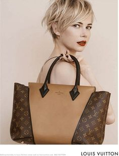 Louis Vuitton W PM - not a fan of monogrammed bags, but this one I LOVE! On my wish list for sure!