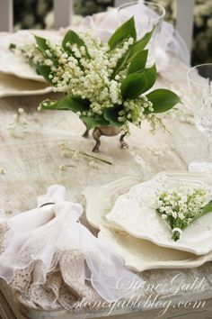 dainty lily of the valley grace a white table for two...