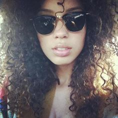 Curly hair and glases.