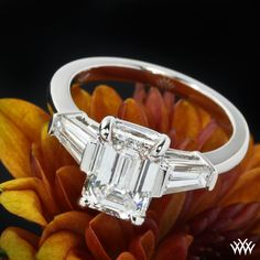 Emerald diamond engagement ring This custom beauty is set in 14k White Gold and features a stunning 1.70ct Emerald Cut center diamond that is flanked by 2 beautiful tappered baguettes
