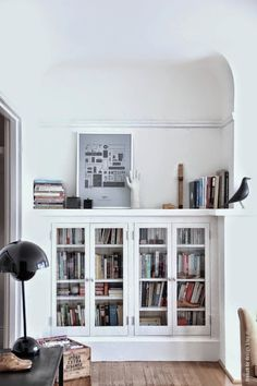 you could use those cabinets in the sun room for books including maybe some cook books