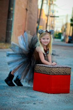 Cheetah Tutu Dress Costume This tutu dress is brown. It has a lined top with brown and cheetah bow accents and brown halter straps. The skirt Halloween Tutu Dress, Halloween Cat, Halloween Costumes For Kids, Princess Tutu Dresses, Cute Kids, Trending Outfits, Bows, Animal Prints, Cheetah
