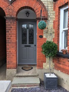 Victorian style front door painted in Farrow & Ball's Mole's Breath. Bay tree in traditional Heritage Garden planter Victorian style front door painted in Farrow & Ball's Mole's Breath. Bay tree in traditional Heritage Garden planter Bay Tree Front Door, Buy Front Door, Front Door Plants, House Front Door, Front Porch, Orange Front Doors, Front Doors With Windows, Front Door Paint Colors, Painted Front Doors
