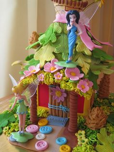 ...tinkerbell cake... Hmm I wonder if Garret could do this one???