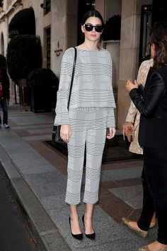 KendallJenner Puts a Feminine Touch on Menswear – Vogue Menswear has been becoming more and more in style for women. Celebrities, like Kendall Jenner, show that it doesn't have to look bulky and heavy. In this image she has on a suit with a men's pattern, but it comes in a simple silhouette which makes it feminine. Brittany H.