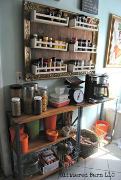 Ikea Hack: Turn Spice Racks and a Large Frame Into Hanging Storage.  This frame was made even uglier by the addition of the completely different style IKEA racks.  Oh, my! What were they thinking?