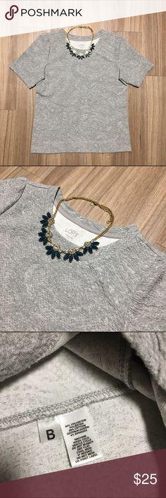 "LOFT Grey Textured Short Sleeve Sweater Tee Thicker knit, ""sweater tee"". Light grey, textured fabric. Great condition! LOFT Tops Tees - Short Sleeve"
