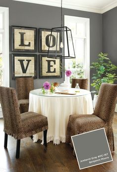 Benjamin Moore Amherst Gray is one of the best neutral dark gray or charcoal paint colours. Shown in small dining room