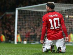 Rooney celebrates his 200th goal.