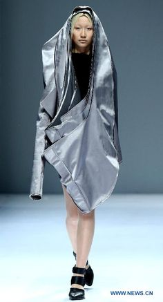 creations designed by graduates from ESMOD Beijing International Fashion Institutes & Universities Group during the 2014 China Graduate Fashion Week in Beijing, capital of China, April 25, 2014. (Xinhua/Chen Jianli)