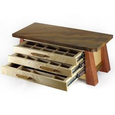 This jewelry box combines a sycamore top, bubinga legs, and some really nicely figured maple on the front. The asymmetry of the slight natural edge in the corner of the top combines with the staggered layout of the drawer pulls for a distinctive look. Overall the jewlery box is 20 wide, 9 deep and 8 high. The drawers are mounted on full extension ball bearing slides which give you full access to the drawers and smooth operation with no maintenance. The interior of the drawers are…