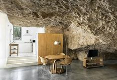 Living and kitchen in a house in the rock, Cuevas del Pino (Spain)