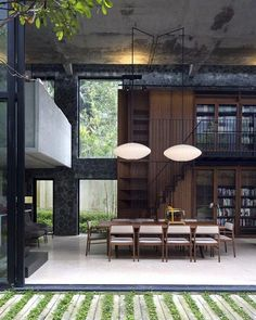 Private library house, Kuala Lumpur Unit One Design #architecture #instarchitecture #archidaily #concrete #doubleheight #mezzanine #bubblelights #georgenelson #stone #stonewall #interiordesign #interiors #instainterior #unitonedesign