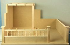 Fast, Easy to Assemble Kit for a Dolls House Garden Scene: Barb's Garden Kit from Miniland is a flat pack garden walled garden kit with an arbor, primarily made from mdf.
