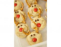 Reindeer Christmas cookies: Just regular peanut butter cookies, small chocolate chips, pretzels and red M's.