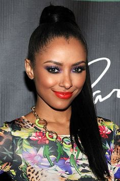 It's rare that someone can pull off a bright purple and a bright red lip, but Kat Graham executed this look flawlessly.