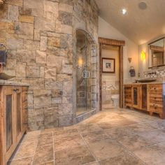 Stone and wood bathroom design with open shower stone for Walk in fireplace designs