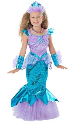 Princess of the Oceans knows there's not much better than a good swim through her realm, greeting her subjects from guppies to whales. Mermaid costume in warm-water colors includes a fishtail dress that provides an underwater, swaying effect when in motion. Finny details show on glovelettes and at waist, too.