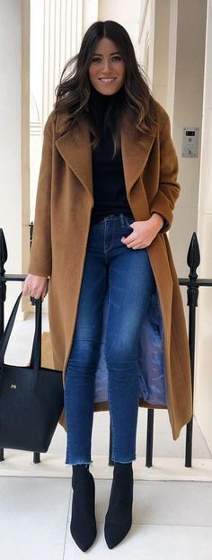 #spring #outfits photo of woman in black top blue jeans and brown coat. Pic by @wearetwinset