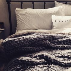 Chunky knits and warm faux fur make this bed irresistible on a winter day. (via @nicole_prince on Instagram)