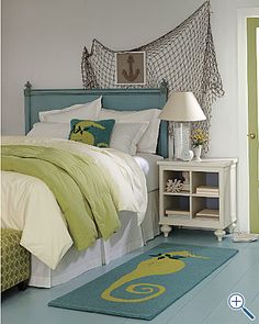 Love the color scheme in this room-- and the seahorses and net -- would make an ADORABLE guest room