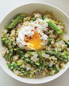 Fried Cauliflower Rice with Asparagus & Egg Whoever came up with the idea of cauliflower rice should get a medal. It's so delicious and fast. I love to mix the runny egg into my rice as a sauce. Cauliflower Fried Rice, Cauliflower Recipes, Veggie Recipes, Low Carb Recipes, Vegetarian Recipes, Cooking Recipes, Healthy Recipes, Cauliflower Couscous, Snack Recipes